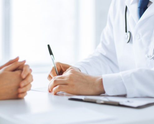 Doctor With Patient - Health Council